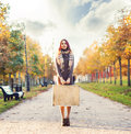 Beautiful Girl With A Suitcase In A Park Stock Images - 76766254