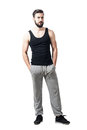 Upset Bearded Athlete In Tank Top And Jogger Pants Looking At Camera. Royalty Free Stock Photo - 76775035