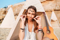 Amusing Woman Making Funny Face In Wigwam On The Beach Royalty Free Stock Images - 76779269