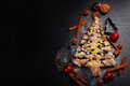 Christmas Tree Shaped Poppy Cake And Black Space For Text Stock Photography - 76789292