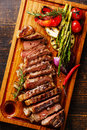 Sliced Grilled Steak Striploin And Vegetables Stock Photo - 76799100
