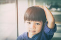 Asian Boy Is Touching His Head And Hair Royalty Free Stock Images - 76806199