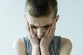 Troubled Young Boy Holding Face In Hands Stock Image - 76811831