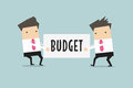 Two Businessmen Are Pulling The Budget To Each Other. Royalty Free Stock Photography - 76818127
