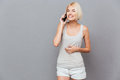 Cheerful Pretty Young Woman Talking On Cell Phone Royalty Free Stock Photography - 76836367