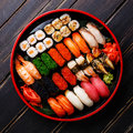 Sushi Set In Black Sushioke Round Plate Royalty Free Stock Photo - 76843495