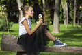 Girl Eating Ice Cream Stock Photo - 76848650