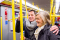 Senior Couple Standing In A Crowded Subway Train Royalty Free Stock Image - 76853516