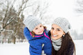 Mother With Her Daughter Hugging Outside In Winter Nature Stock Photos - 76854203