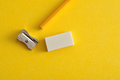 A Sharpener, Eraser And Yellow Pencil Royalty Free Stock Image - 76871106