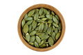 Top View Of Roasted Pumpkin Seeds In Wooden Bowl. Dry Pepita Aft Stock Photo - 76871860