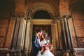 Groom And Bride Near The Doors Royalty Free Stock Image - 76892966