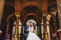 Groom And Bride Near The Columns Royalty Free Stock Photo - 76893185