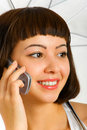 Brunette Talking On A Cellular Phone Royalty Free Stock Photos - 7693928
