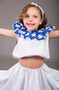 Cute Little Girl Wearing Beautiful White And Blue Dress With Matching Head Band, Actively Posing For Camera, Studio Royalty Free Stock Images - 76910249