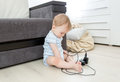 Baby Sitting Alone In Living Room And Playing With Electrical Ca Royalty Free Stock Photo - 76915965