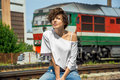 Portrait Of Charming Girl Sitting On A Railway Track Royalty Free Stock Images - 76917979