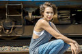 Portrait Of A Divine Girl Sitting On A Railway Track Royalty Free Stock Images - 76917989