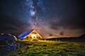 Hut In The Mountains At Night Under The Milkyway Stock Images - 76919194