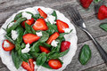 Strawberry Salad With Spinach And Feta Cheese On Wooden Table Stock Images - 76921404