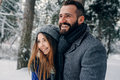 Happy Loving Couple Walking In Snowy Winter Forest, Spending Christmas Vacation Together. Outdoor Seasonal Activities Stock Photography - 76929212