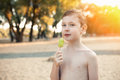 Little Boy Eating Icecream And Smile; Stock Images - 76956934