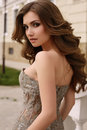 Beautiful Woman With Dark Curly Hair In Luxurious Sequin Dress Stock Photo - 76964090