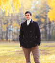 Handsome Man Wearing A Black Coat Jacket In Autumn Day Stock Image - 76969841