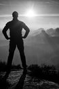 Self Confident Man On Rock Watching Foggy Landscape Up To Horizon Stock Photos - 76985803