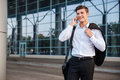 Businessman In White Shirt Talking On Cell Phone Outdoors Royalty Free Stock Photography - 76987277