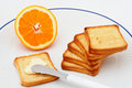 Toast With Butter And Half Orange Royalty Free Stock Image - 773046