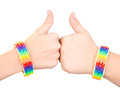 Female Hands With A Bracelet Patterned As The Rainbow Flag Showing Thumbs Up. Isolated On White Background Stock Photography - 77063632