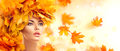 Autumn Woman. Beauty Model Girl With Autumn Bright Leaves Hairstyle Stock Images - 77079894