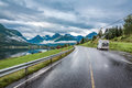 Caravan Car Travels On The Highway. Royalty Free Stock Photo - 77086575