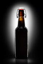 Swing Top Bottle Of Light Beer Isolated On Black Background Royalty Free Stock Photography - 77117457