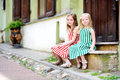 Two Adorable Little Sisters Having Fun On Famous Literatu Street In Vilnius Stock Image - 77122791