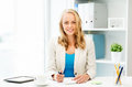 Businesswoman Writing To Notebook At Office Stock Photo - 77128570
