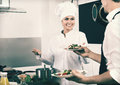 Woman Cook Giving To Waitress Ready To Serve Salad Royalty Free Stock Photos - 77134088