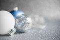 Blue, Silver And White Xmas Ornaments On Glitter Holiday Background. Merry Christmas Card. Stock Photography - 77144992