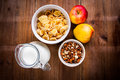 Light Healthy Breakfast: Cornflakes, Milk, Apples And Nuts Royalty Free Stock Photo - 77158285