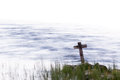 Wooden Cross Standing On The Shore With Streaming Water Stock Images - 77168994