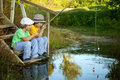 Happy Boys Go Fishing On The River, Two Children Of The Fisherma Royalty Free Stock Images - 77175689