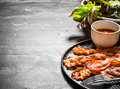 Fried Bacon With Sauce And Greens. Stock Photography - 77196762