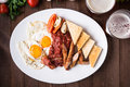 English Breakfast (fried Eggs, Beans, Roasted Bacon, Sausages And Vegetables) On Dark Wood Background Royalty Free Stock Images - 77199689