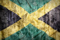 Grunge Style Of Jamaica Flag On A Brick Wall Royalty Free Stock Photos - 77222448