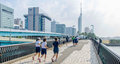 Fukuoka, Japan - June 30, 2014: Japanese High School Students Running In Momochi Beach Road.This Road Heading To Fukuoka Tower Stock Images - 77229204