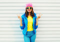Fashion Pretty Cool Smiling Girl In Colorful Clothes Having Fun Over White Background Wearing A Pink Hat Yellow Sunglasses Royalty Free Stock Photo - 77250705