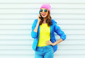 Fashion Happy Cool Smiling Girl Talking On Smartphone In Colorful Clothes Over White Background Wearing Pink Hat Yellow Sunglasses Royalty Free Stock Photography - 77250737