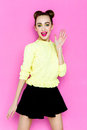 Pretty Young Playful Girl Dressed In Green Pullover And Black Skirt. Royalty Free Stock Images - 77251869