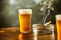 Ice Cold Lager Or Beer With A Burning Cigarette Stock Photos - 77268393